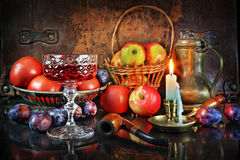 Evening of difficult day after harvesting. A still life by candlelight with vegetables and fruit in a retro style Royalty Free Stock Photography