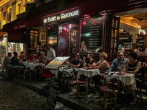 Evening diners crowd outside tables at Montmartre restaurant Royalty Free Stock Images
