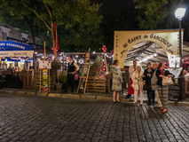 Evening diners pause outside outdoor cafe area, Place du Tertre, Paris, France Stock Image