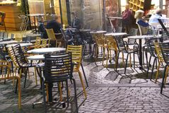 Evening diners relax in an outdoor restaurant Stock Images