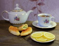Evening dinner. Hot tea, Patty, lemon the best food Royalty Free Stock Photo