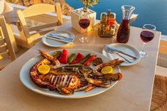 Evening dinner with seafood. And red wine on the beach sea stock photography