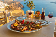 Evening dinner with seafood. And red wine on the beach sea royalty free stock images