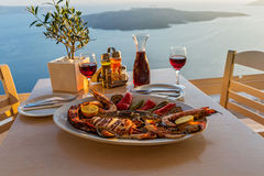 Evening dinner with seafood. And red wine on the beach sea stock photo