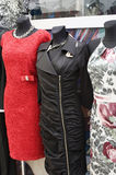 Evening dresses. Stylish dressed mannequins in boutique display Royalty Free Stock Photo