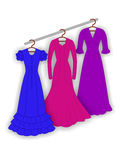 Evening dresses. On a white background Stock Photography