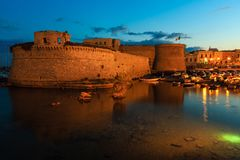 Evening Gallipoli Castle, Puglia,  Italy. Evening dusk in Gallipoli, province of Lecce, Puglia, southern Italy.  View from walls of Angevine-Aragonese medieval Stock Photo