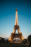 Evening Eiffel tower illuminated Stock Images