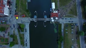 Evening in Elblag town. Bird-eye view of the bridge in Elblag old town at evening stock video