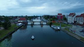 Evening in Elblag town. Bird-eye view of the bridge in Elblag old town at evening stock footage