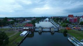 Evening in Elblag town. Bird-eye view of the bridge in Elblag old town at evening stock video footage