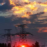 The evening electricity pylon silhouette, it is very beautiful. Royalty Free Stock Photo