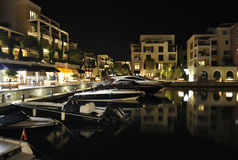 Evening embankment with reflection in Porto Montenegro. TIVAT, MONTENEGRO – AUGUST 9th, 2015: View of evening embankment with reflection in Porto Montenegro Royalty Free Stock Photos
