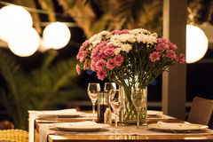 Evening event. With a beautiful table setting for two people Stock Images