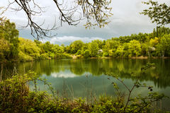 Evening falls over green lake stock photos