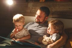 Evening family reading. father reads children . book before goin Royalty Free Stock Photo