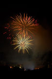 Evening fireworks. On the background of the city skyline royalty free stock photos