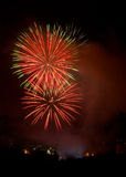 Evening fireworks. On the background of the city skyline royalty free stock images