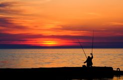Evening fishing. On the black sea, silhouette Stock Photos