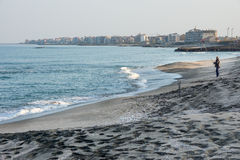 Evening fishing on black sand in Pomorie, Bulgaria Royalty Free Stock Images