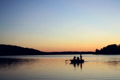 Evening fishing at the lake. Boat with fishermen. Royalty Free Stock Images