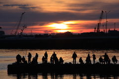 Evening fishing. Evening in Sochi, the local population goes to fishing Stock Photography
