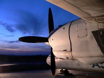 Evening flight. Retro plane on stop in the evening Stock Photo