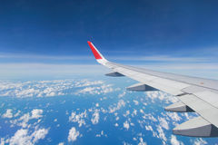 Evening flight on cloud and blue sky, amazing view from the wind Stock Images