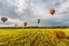 Evening flight of the hot air balloons Stock Images