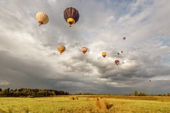 Evening flight of the hot air balloons Stock Photography