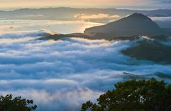 Evening fog covering the sea coast. Stock Image