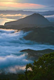 Evening fog covering the sea coast. Royalty Free Stock Image