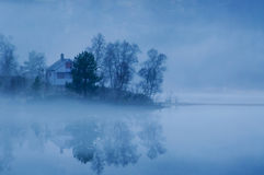 Evening fog by the lake Stock Images