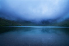 Evening fog on a mountain lake Stock Photography