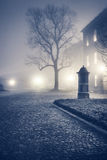Evening foggy street of old european town. Evening urban landscape. Foggy street of old european town Krakow in Poland. Looks like London. United Kingdom. With Royalty Free Stock Images