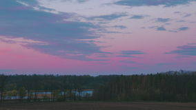 Evening at the forest near river. Beautiful purple sky stock footage