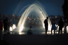 The evening at the fountain on the waterfront stock photo