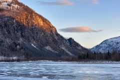 Evening at frozen Siberian river stock images