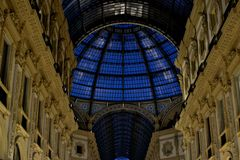 Blue hour  in the gallery of Vittorio Emanuele in Milan. Evening autumn day inside the Vittorio Emanuele Gallery Milan Italy royalty free stock photography
