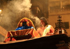 Evening Ganga Aarti in Varanasi. A group of priests daily in the evening at this Dashashwamedh ghat perform Agni Pooja (Worship to Fire) wherein a dedication is Royalty Free Stock Photo