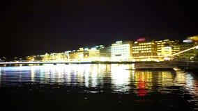 Evening Geneva city, beautiful view on lake and embankment, romantic scene. Stock footage stock video