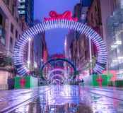 Evening on George Street, Sydney during Christmas retail period. Just after rain. Streets are damp and illuminated stock image