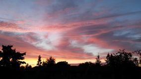 Evening Gleam. Sky of colorful clouds Stock Photo