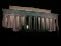 An evening Glimpse of the Lincoln Memorial. A cresent moon slowly sets behind the Lincoln memorial in Washington, D.C. late July 2006 Royalty Free Stock Photos