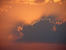Evening glow. The sun was hidden by the clouds Royalty Free Stock Photo
