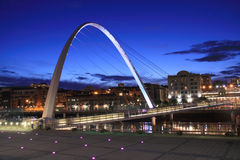 Evening Glow. The Gateshead Millennium Bridge spanning the River Tyne between Gateshead & Newcastle, England Stock Image