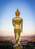 Evening, golden buddha statue in Khao Noi temple, Nan Province Royalty Free Stock Photography