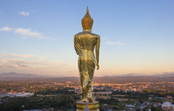 Evening, golden buddha statue in Khao Noi temple, Nan Province, Royalty Free Stock Photography