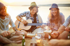 Evening with guitar Stock Image