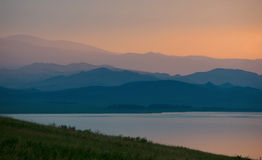 Evening hillsides and the lake. Royalty Free Stock Photography